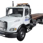Freightliner M2 Komatsu Flatbed Tow Truck with Jerr-Dan Rollback Carrier 1/34 Diecast Model by First Gear