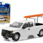 2015 Ford F-150 XL White Work Pickup Truck with Ladder Rack and Ladder Pickup Truck Country Roads Series 14 1/64 Diecast Model Car by Greenlight
