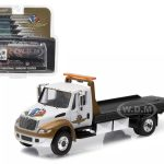 2016 International Durastar 4400 IMS Wheel Wings and Flag Flatbed Tow Truck White and Gold 1/64 Diecast Model by Greenlight