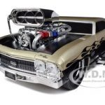 1969 Chevrolet Chevelle Gold/Black Muscle Machines 1/18 Diecast Model Car by Maisto