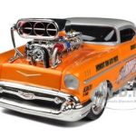 1957 Chevrolet Bel Air Muscle Machines Orange 1/24 Diecast Model Car by Maisto