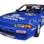 Nissan Skyline GT-R (R32) Group A 1990 Calsonic #12 With Driver Figurine and Display Case 1/18 Limited to 1000pc by Diecast Model Car AutoArt